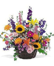Basket overflowing with gorgeous summer flowers