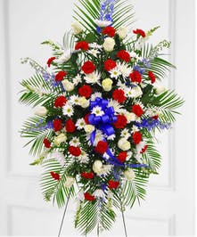 This patriotic spray is a perfect honor for a brave solider.