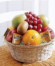 Indulge in this basket of decedent chocolates and fruit to die for!