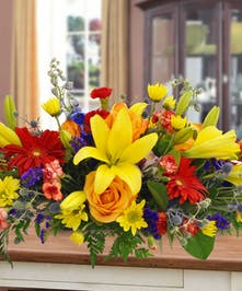 An array of brightly colored flowers in stunning colors creates a statement for your table.