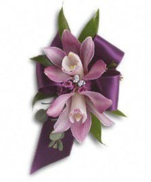 Purple miniature cymbidium orchids, lavender waxflower, Italian ruscus and parvifolia eucalyptus. Approximately 4 1/4 W x 7 H