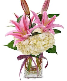 Mirror the happiness she shows with this beautiful arrangment of Stargazer lilies and Hydrangea, sure to ignite her sense and warm her heart.