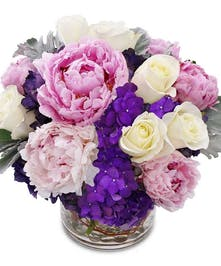 Celebrate mom this year with this gorgeous bright bouquet!