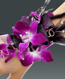 Purple orchid wristlet with black feathers, rhinestone sprays, and upgraded dazzle crystal wristlet