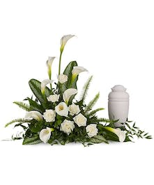 Place the arrangement on a table next to an urn, guest book or collection of framed photographs as a graceful tribute