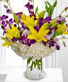 A cheerful design, donned with a crown of bright yellow Lilies
