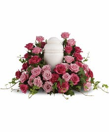 Cremation Arrangement Embraced by Pink Roses