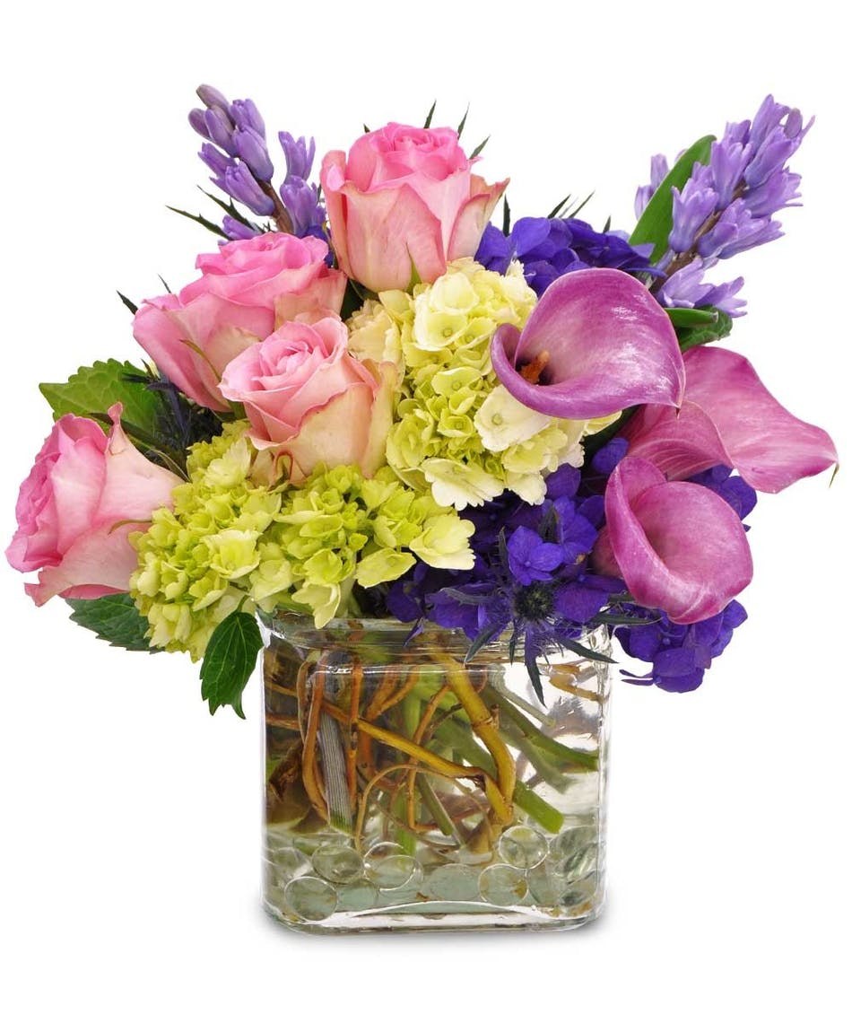 Bright blooms calla lilies pink roses hydrangea city line calla lilies in a bright pink hue are accented with green hydrangea and lovely pink roses izmirmasajfo