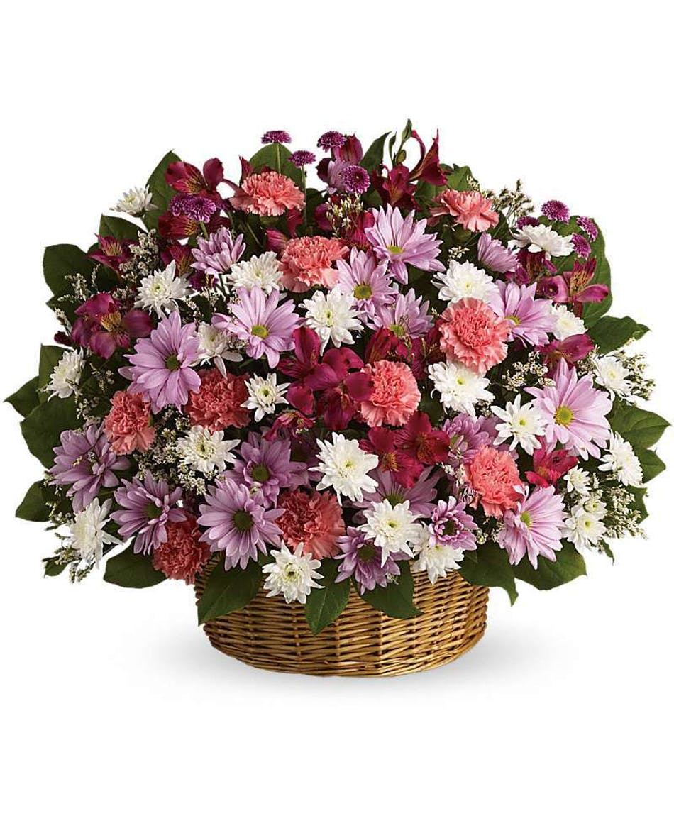 Rainbow reflections basket custom funeral design funeral basket send comfort to the family with these abundant flowers beautifully contained in a wicker basket izmirmasajfo